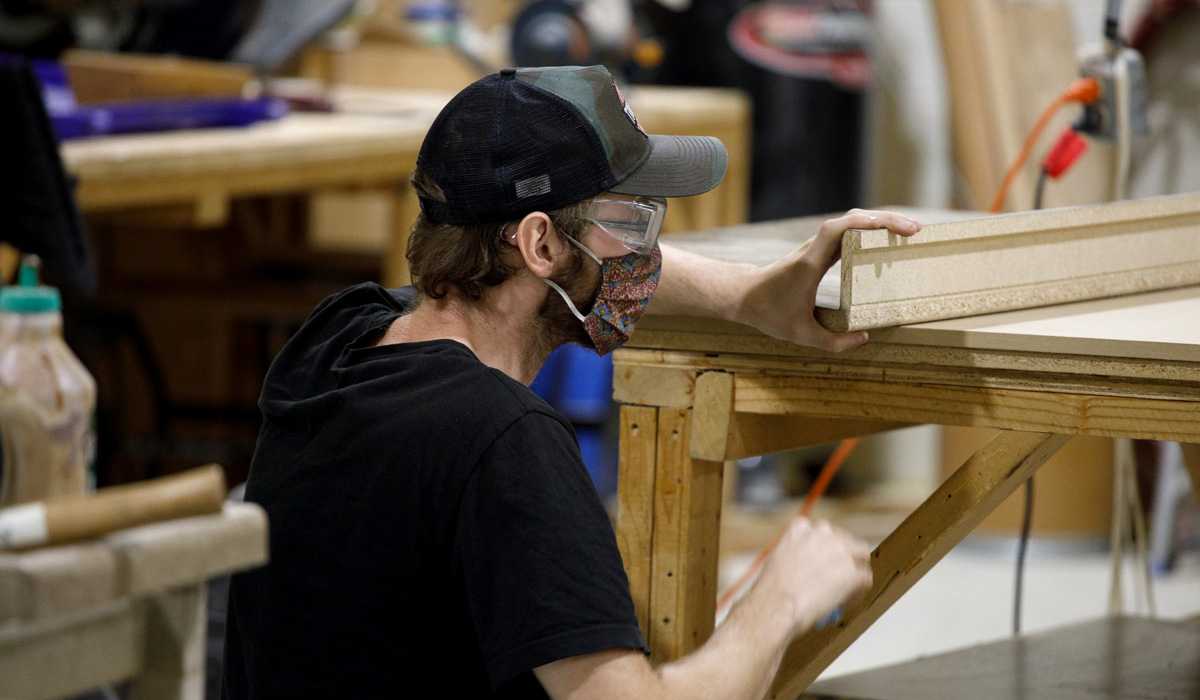 Youth working in the wood shop